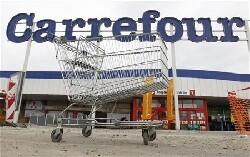 Passation de pouvoirs anticipée chez Carrefour, le titre reflue
