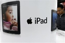 Apple : le marché salue la hausse du bénéfice et attend l'iPhone 6